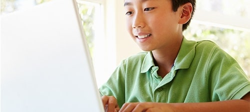 Image of kid learning at fast speeds with HughesNet Gen5